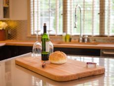 A small drop of butcher-block material from an undermount sink cut-out is repurposed as a new oversized cutting board.