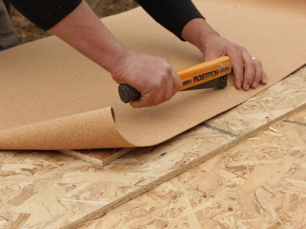 Use a hammer-tacker to staple the cork around the edges of the board.