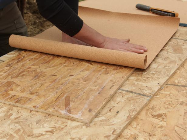 Start at one end and evenly roll cork across the sheathing.