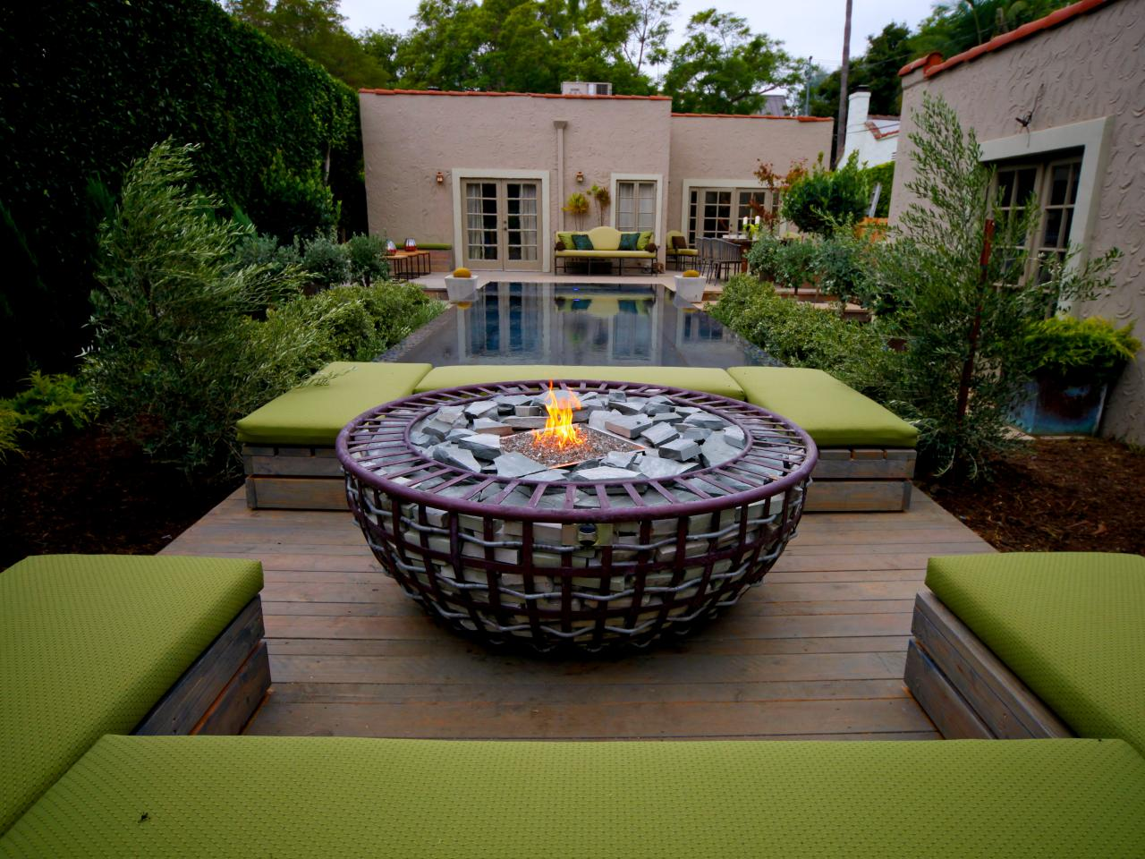 66 fire pit and outdoor fireplace ideas diy network blog for Garden pool haiti