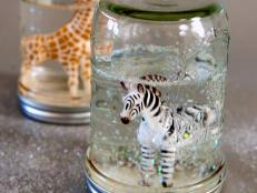 Snow globes are often a treasured souvenir from world travels. Now you can help the kids create a handmade version with their favorite figurines or personal mementos.
