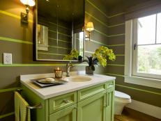 A diminutive space inspired by beautiful marsh scenery, the powder room hints at the first-floor color palette and design style.