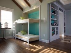 Transform a spare room or media room into a guest bedroom with addition of a Murphy bunk bed that holds two twin mattresses.