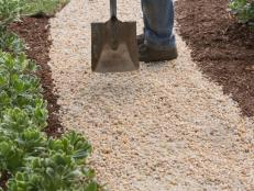 Carve out a stone-paved path that winds past areas of interest in your yard.