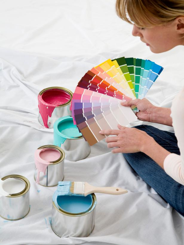 Woman Holding Paint Swatches
