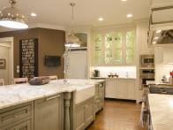 CI-McGilvrayWoodworks_hgrm-room-stories-French-Country-kitchen-backside-island-JDK0285_h
