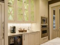 CI-McGilvrayWoodworks_hgrm-room-stories-French-Country-kitchen-bar-area-oven-JDK0277_h