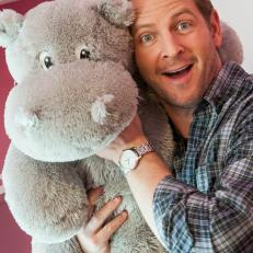 Jason Cameron Poses with Stuffed Hippo
