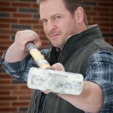Jason Cameron Poses with Sledgehammer