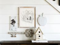How to Make a Whitewash Wall Display With Garage Sale Items