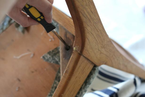 Use a drill or screwdriver to remove the existing chair cushion.