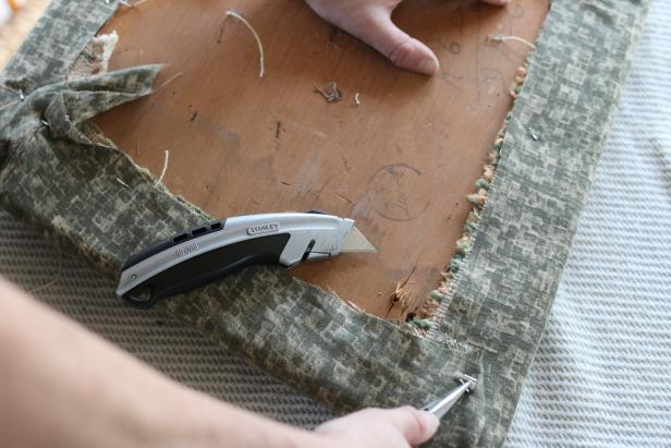 Remove the existing fabric from the chair cushion using a utility knife and/or needle nose pliers.