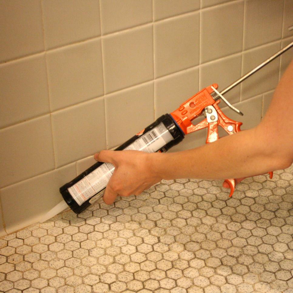 bathroom tile caulk fixes to get your home ready to put on the market diy 11570 | Original Emily Fazio Replace Caulk install new silicone shower floor.JPG.rend.hgtvcom.966.966