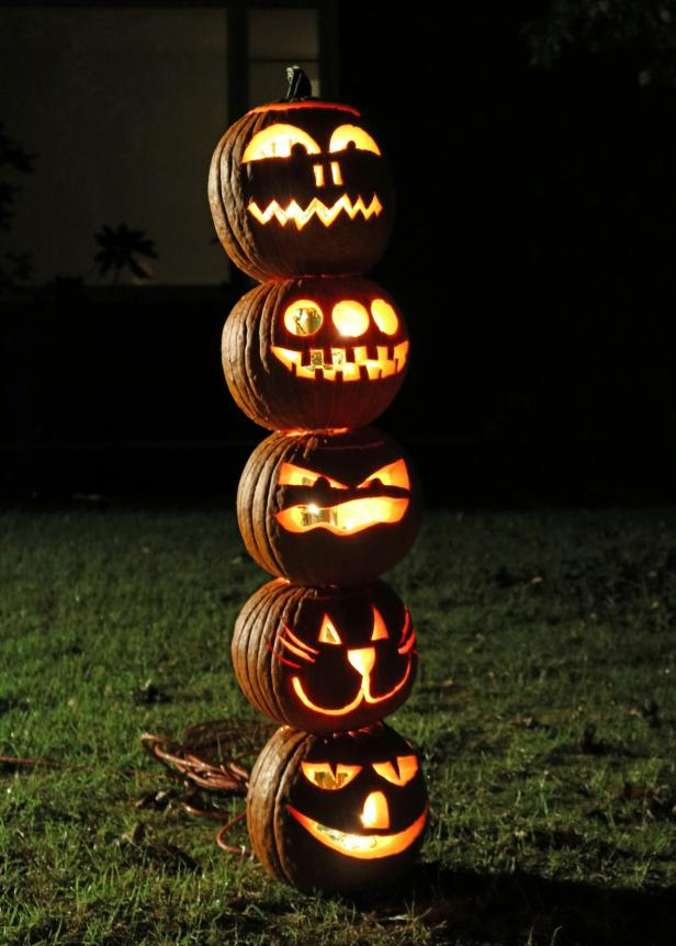 Stack and light the pumpkins for a creative outdoor display.