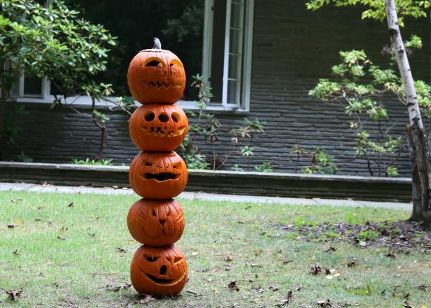 Stack all pumpkins on the fence post.