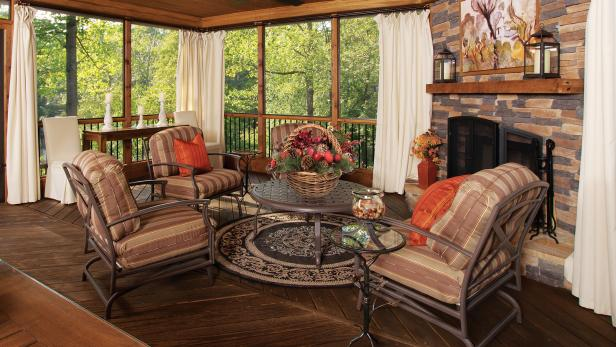 Rustic Screened Porch with Stone Fireplace