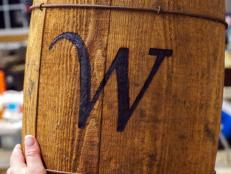 Learn how to monogram a wood vessel like a crate, barrel or box using a wood burning iron or a flat-tip soldering tool.