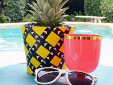 Give your patio a little tropical flare by growing a pineapple plant in a planter that looks like a pineapple.