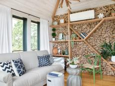 For a rustic, Scandanavian style, try cladding a wall in small pieces of firewood. It's inexpensive because there's not a lot of materials required, and it's easy because the look is freeform to your style.