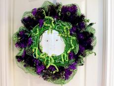 The legend goes if you look into the eyes of Medusa you will turn to stone. Make people do a double-take with this wreath that also doubles as a glass etched mirror with the red eyes of Medusa.