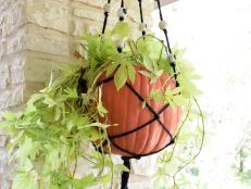 Learn how to combine a faux pumpkin with macrame to make a hanging planter.
