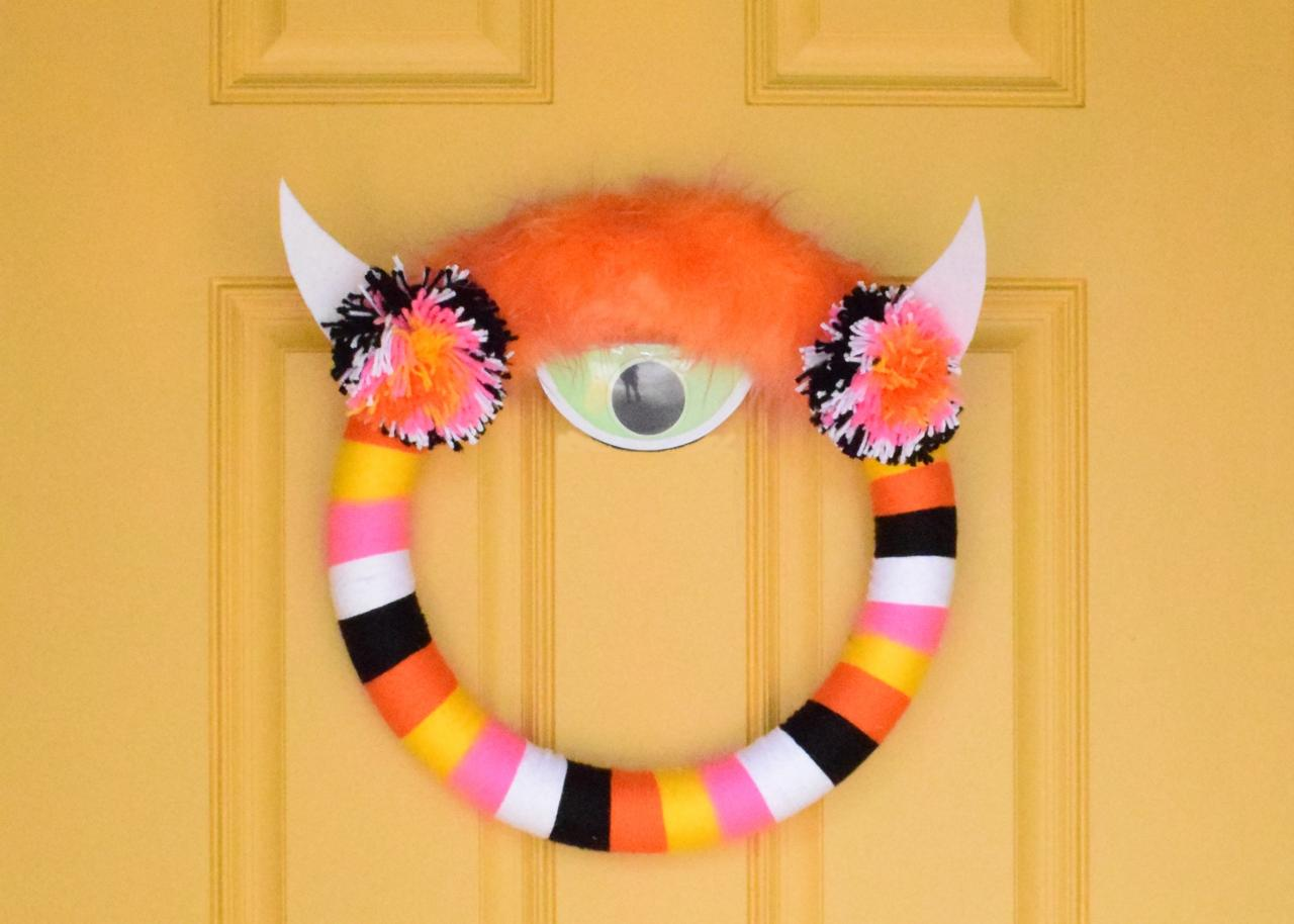 How To Make A Halloween Yarn Wrapped Monster Wreath How Tos Diy