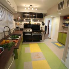 Kitchen with Green Cabinets and Matching Floor Tiles