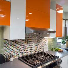 Mid-Century Modern Kitchen With Glossy Orange Cabinets