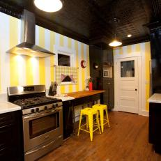 Black, Yellow and White Modern Kitchen with a Tin Tile Ceiling