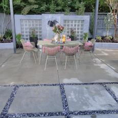 Patio with Faded Green Table with Pink Pillows