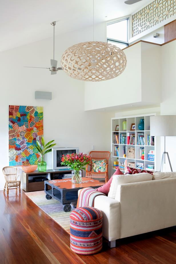 Open Living Room Features Colorful Art, Boho Chandelier