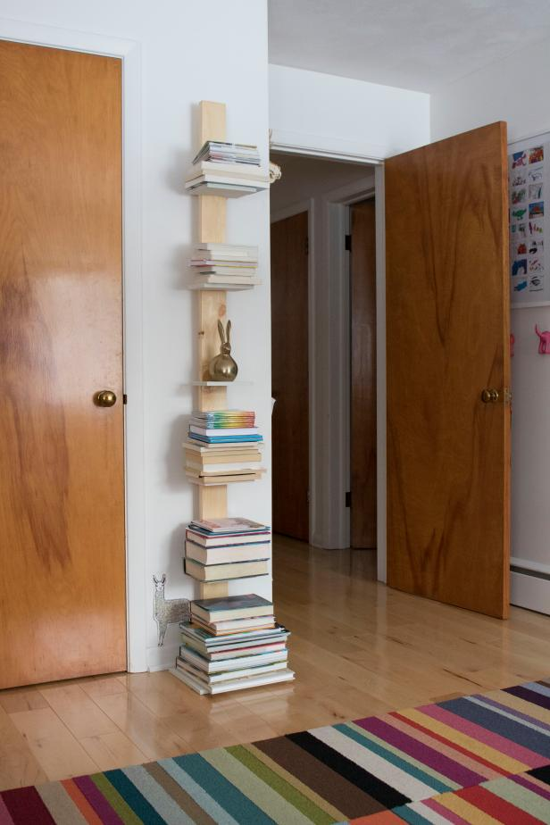 Use MDF and a 2x4 to build a vertical book tower.