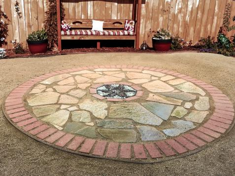 How to Make a Brick and Flagstone Patio With a Pebble Mosaic Inset
