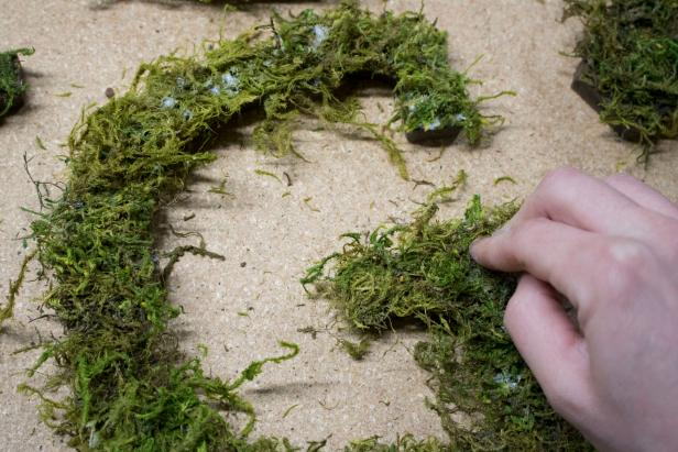 Learn how to make these mossy-covered garden letters for your garden.